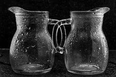 Vidrios en descensos del agua Fotografía de archivo
