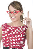 Vidrios enmarcados rojo que llevan de la mujer que soportan el finger Foto de archivo libre de regalías