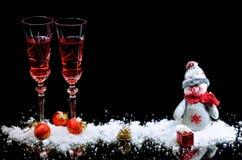 Vidrios festivos de vino Celebración del Año Nuevo y de la Navidad Imagen de archivo