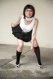 Vidrios que desgastan de la muchacha asiática linda Fotografía de archivo libre de regalías