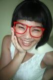 Vidrios que desgastan de la muchacha asiática linda Imagen de archivo libre de regalías