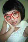 Vidrios que desgastan de la muchacha asiática linda Imagen de archivo