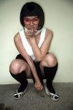 Vidrios que desgastan de la muchacha asiática linda Imágenes de archivo libres de regalías