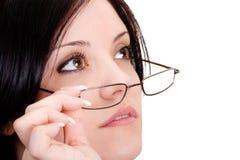 Vidrios que desgastan de la mujer Foto de archivo libre de regalías