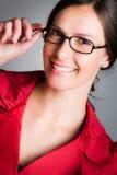 Vidrios que desgastan de la mujer de negocios Foto de archivo