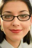 Vidrios que desgastan de la mujer joven Imágenes de archivo libres de regalías