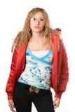 Vidrios que desgastan rubios jovenes en chaqueta roja Imagenes de archivo