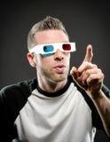 Vidrios que llevan 3d y el señalar Imagen de archivo libre de regalías