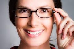 Vidrios que llevan de la mujer Imágenes de archivo libres de regalías