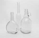 Vidrios vacíos de diversas formas Foto de archivo