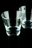 Vidrios vacíos en un fondo negro Fotografía de archivo libre de regalías