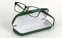 Vidrios verdes con la caja Fotografía de archivo