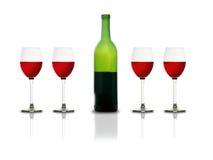 Vidrios y botella de vino rojo Fotografía de archivo