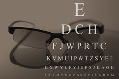 Vidrios y carta de prueba del ojo Fotografía de archivo