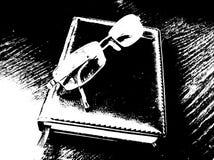 Vidrios y cuaderno accesorios Fotografía de archivo