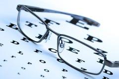 Vidrios y eyechart Imagen de archivo libre de regalías