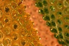Vidro alaranjado, verde, e amarelo com colisões Imagens de Stock