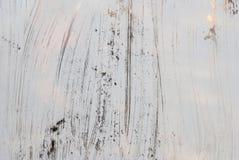 Vidro branco sujo do fundo pintado com pintura branca Imagem de Stock