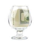 Vidro com cédulas dobradas para dentro Imagens de Stock Royalty Free
