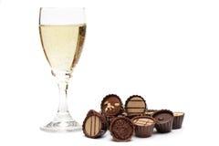 Vidro de Champagne e de chocolate Foto de Stock