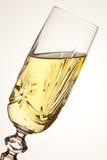Vidro de Champagne inclinado Imagens de Stock