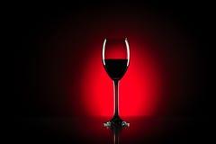 Vidro de vinho tinto no estúdio Imagem de Stock Royalty Free