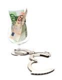 Vidro do conhaque com dinheiro Foto de Stock Royalty Free