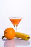 Vidro do suco com bananas e laranjas Imagem de Stock Royalty Free