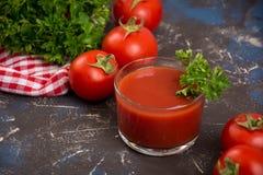 Vidro do suco de tomate Foto de Stock Royalty Free