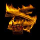 Vidro do uísque e do fogo Imagem de Stock Royalty Free