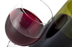 Vidro e frasco do vinho vermelho Fotografia de Stock