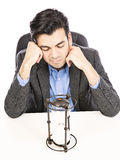 Vidro e homem de negócios da hora Imagem de Stock