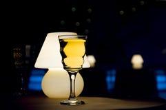 Vidro e lâmpada de vinho Imagens de Stock Royalty Free