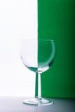 Vidro no fundo branco e verde Fotografia de Stock Royalty Free