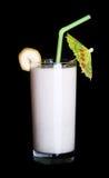 Vidro saudável do sabor da banana dos batidos no preto Imagem de Stock Royalty Free