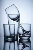 vidro vazio do grupo no fundo claro azul Imagem de Stock Royalty Free