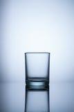 Vidro vazio no fundo claro azul Fotografia de Stock