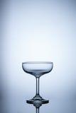Vidro vazio no fundo claro azul Fotografia de Stock Royalty Free