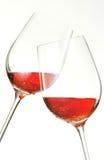 Vidros clinking bebendo e dizer do vinho elogios Imagens de Stock Royalty Free