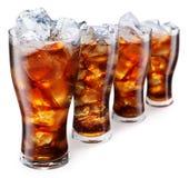 Vidros com os cubos da cola e de gelo Fotografia de Stock Royalty Free
