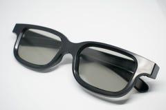 vidros 3D em um fundo cinzento Visão moderna do cinema Imagem de Stock Royalty Free
