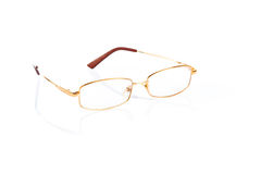 Vidros da cor do ouro para a vista maçante no fundo branco Imagem de Stock Royalty Free
