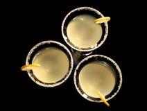 Vidros da gota de limão martini com fatias de fruto Imagem de Stock