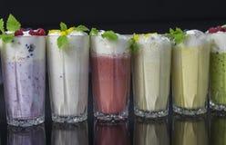vidros de vários milks shake Imagem de Stock Royalty Free
