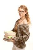 Vidros desgastando da menina bonita com livros Fotografia de Stock