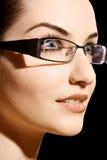 Vidros desgastando da mulher Fotos de Stock