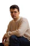 Vidros desgastando do homem que se está sentando Foto de Stock Royalty Free