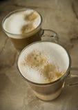 Vidros do café com leite espumado Fotos de Stock Royalty Free