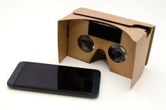 Vidros do cartão da realidade virtual Forma facil olhar filmes em 3 Foto de Stock