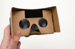 Vidros do cartão da realidade virtual Forma facil olhar filmes em 3 Imagens de Stock